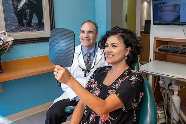 Dr. Gopin with a patient at Bruce Gopin, DDS, MS in El Paso, TX.